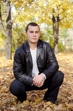 Outdoors portrait of young man in autumn park  Stock Photo - 11503457