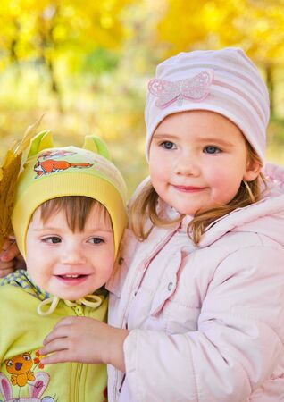 Two little  cute girls in autumn park photo