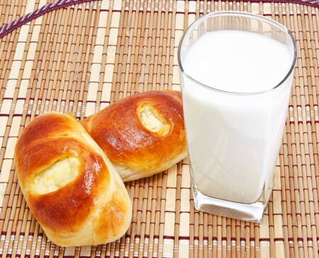 Composition of fresh buns and glass of milk  Stock Photo - 11622531