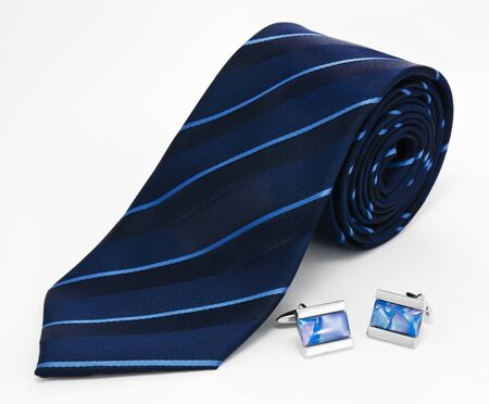 Man cuff links and tie  isolated on white background photo