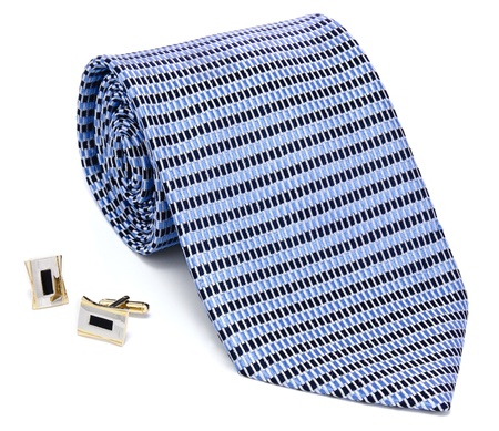 cuff links: Man cuff links and tie  isolated on white background