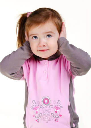 Portrait of little girl covering her ears with hands on a white Stock Photo - 12614391