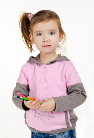 Portrait of cute little girl with a pencils isolated Stock Photo - 12966240