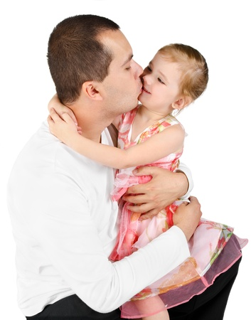 Father kissing little girl  isolated on a white  photo