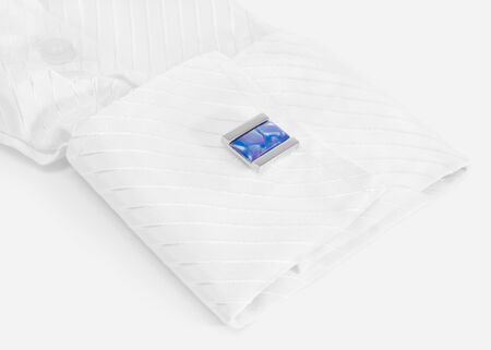 White sleeve with blue cuff link on a white Stock Photo - 13785852