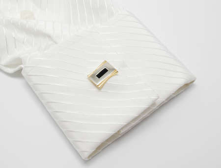 White sleeve with cuff link on a white Stock Photo - 13883330