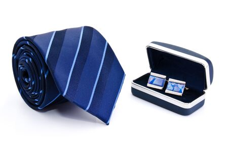 Man cuff links in box and tie  isolated on white photo