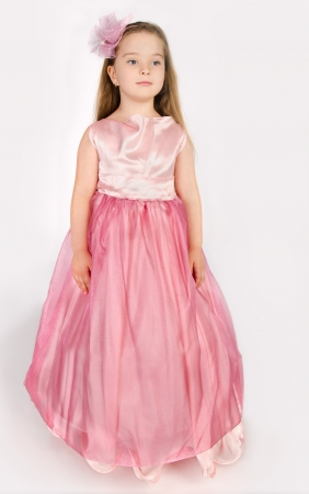 Portrait of cute smiling little girl in princess dress  isolated photo
