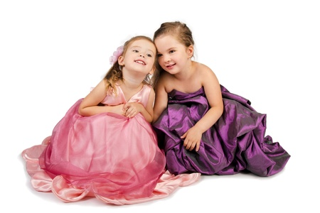 Two little girls speaking with each other isolated Stock Photo