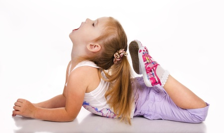 Gymnast cute little girl isolated on a white Stock Photo