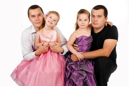 Portrait of two cute little girls with their twins fathers isolated photo