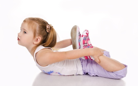 female gymnast: Gymnast cute little girl isolated on a white Stock Photo