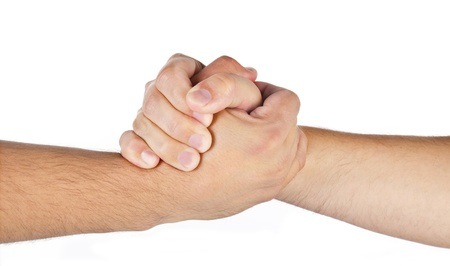 Arm wrestling hands of two men isolated on a white photo
