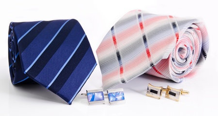 Man cuff links and tie  isolated on white photo