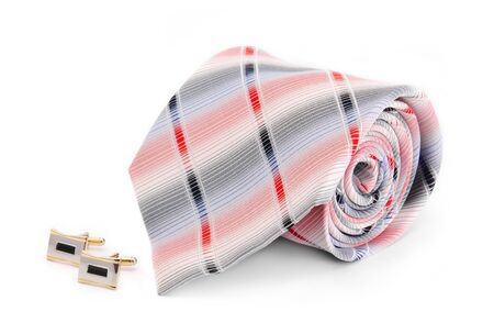 Man cuff links and tie  isolated on a white photo