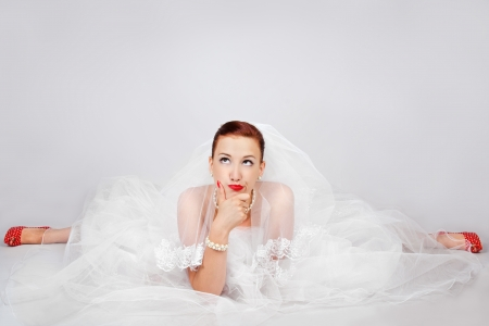 Portrait of young beautiful bride in red shoes