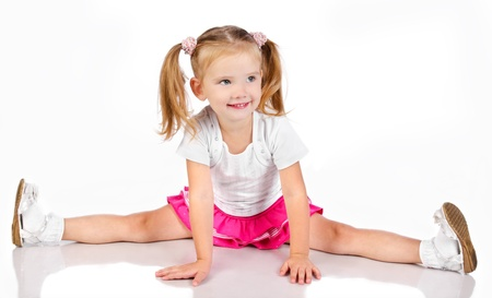 Portrait of cute sitting smiling little girl isolated Stock Photo