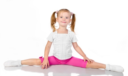 Gymnast cute little girl isolated on a white photo