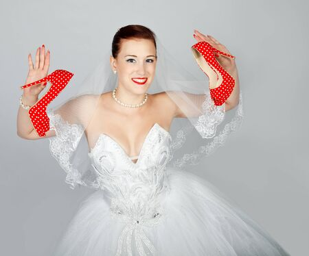Portrait of young beautiful bride with  red shoes isolated photo