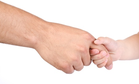 Child holds the finger of father isolated Stock Photo