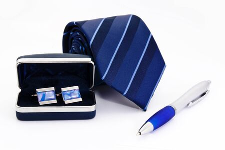 Man cuff links in box pen and tie  isolated on white photo