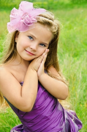 little girl smiling: Outdoor portrait of cute little girl in princess dress