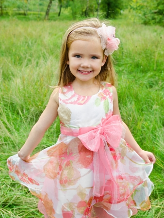 Outdoor portrait of cute little girl in princess dress