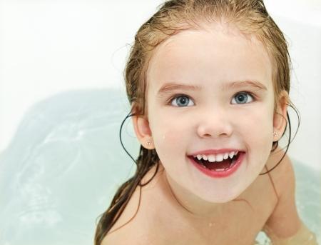 Cute little girl is taking a bath