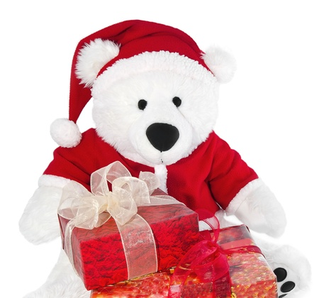 Bear with christmas hat and box on a white background photo