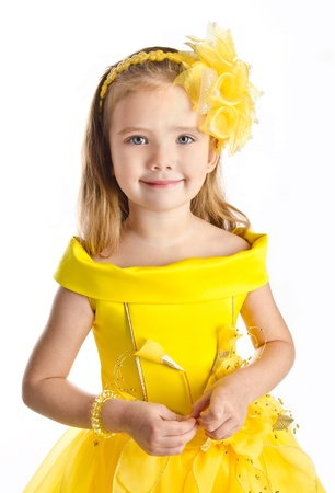 yellow dress: Portrait of cute little girl in princess dress isolated