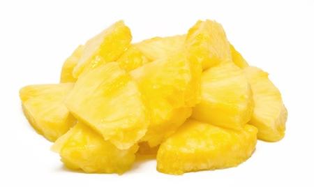 chunks: Heap of pineapple chunks isolated on white