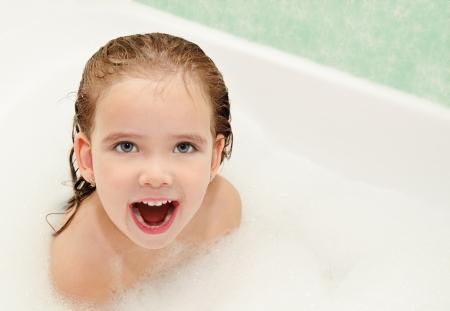 bathwater: Shouting cute little girl is taking a bath