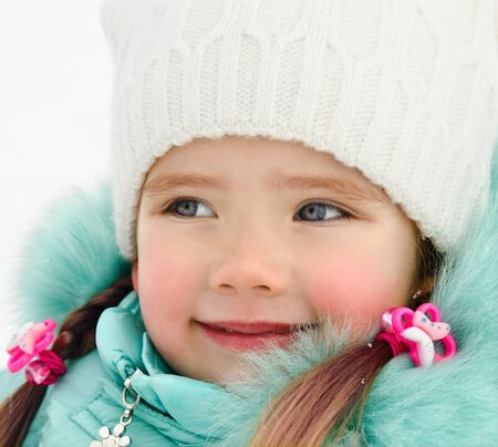 january 1: Outdoor portrait of beautiful little girl in winter day