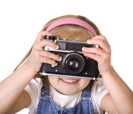 Photographing little girl with old camera isolated on white photo