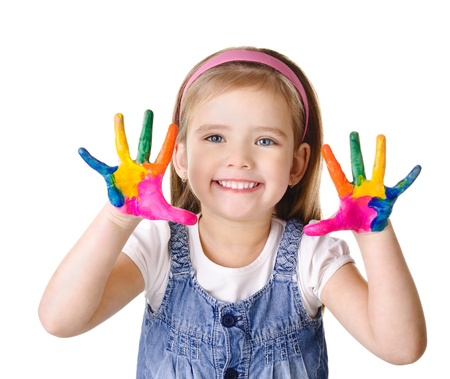 Beautiful smiling little girl with hands in the paint isolated on white