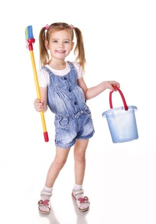 Cute little girl with mop and bucket is ready to clean isolated on white photo