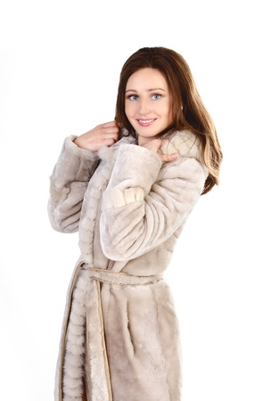 attracive: Attracive young woman in a fur coat isolated on white