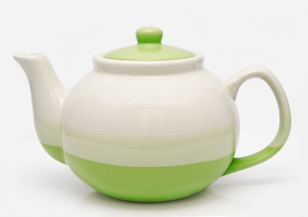 Green teapot isolated on a white background  Imagens