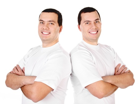 Two attractive positive smiling young men twins isolated on white