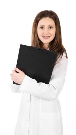 plane table: Sonriente mujer joven m�dico con estetoscopio y una mesa de avi�n aislado en blanco