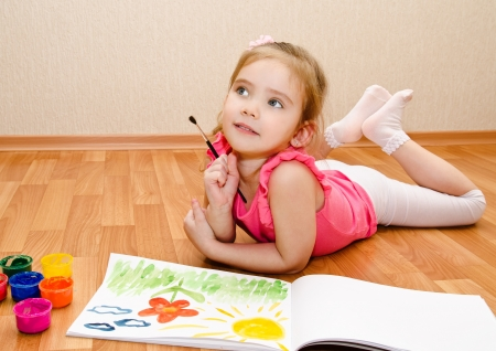 Little girl drawing with paint at home  Stock Photo - 18394735