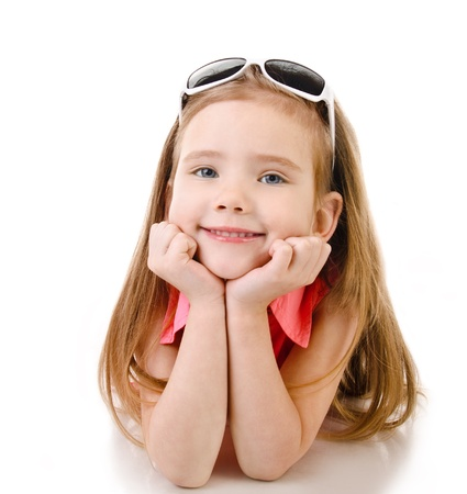 Portrait of smiling cute little girl isolated over white photo