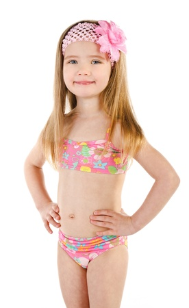 bathing suits: Cute smiling little girl in swimsuit isolated on white background