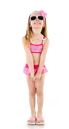 Happy little girl in swimsuit and sunglasses isolated on white background  Stock Photo