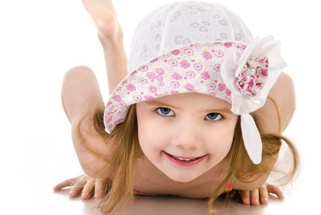 Portrait of lying cute little girl isolated over white photo
