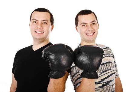 Two attractive smiling young men twins in boxing gloves isolated on white Stock Photo