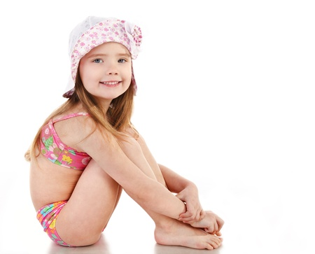 bathing   suit: Cute smiling little girl in swimsuit and cap isolated on white background