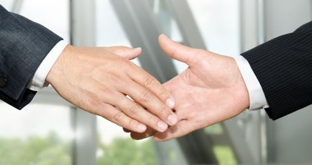 Male handshake isolated on business background  photo