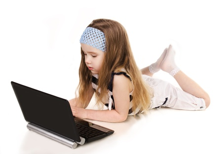 Cute little girl with laptop isolated over white Stock Photo - 20048295