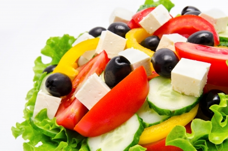 ready to cook food: Fresh vegetable salad isolated on a white